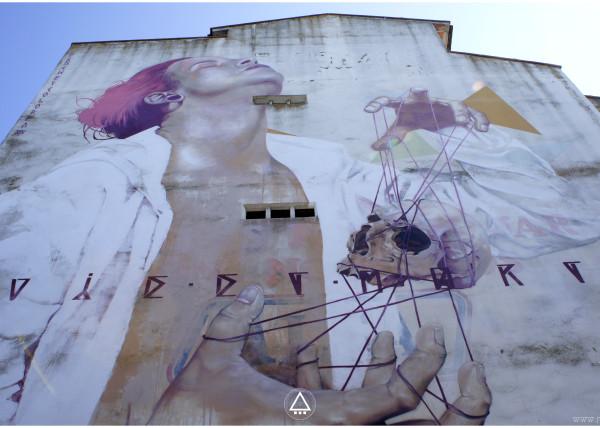 via y muerte fachada graffiti profesional